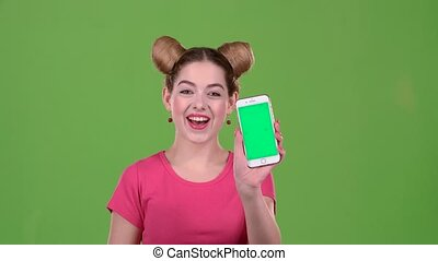 Teen advertises the phone and shows a thumbs up. Green screen