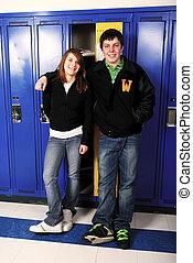 A teenage couple during highschool break.