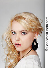 teen aged portrait - close up head shots of a blond teenaged...