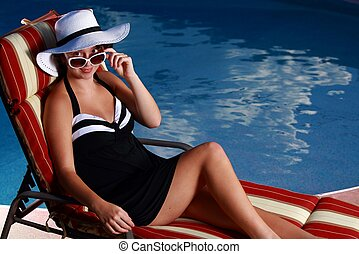 teen-ager by pool - teen -ager by pool looking down sun...