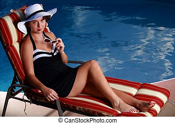 teen ager modeling by pool - teen ager relaxing by pool