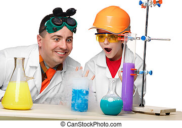 Teen and teacher of chemistry at lesson making experiments -...