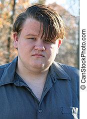 Portrait of unhappy teenage boy.