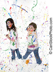 Teen Artist - Two beautiful teen girls covered in paint with...