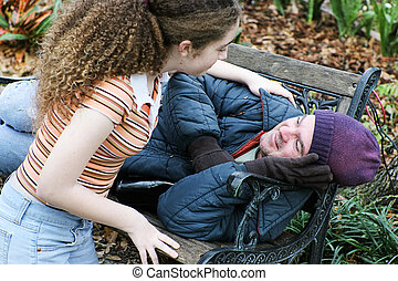 Teen Assists Homeless Man - Teen girl volunteers to help...