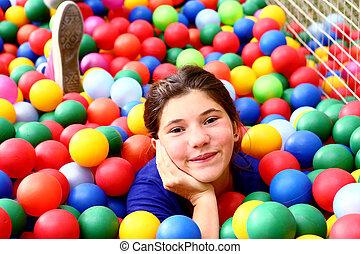 teen beautiful girl in color balls pool