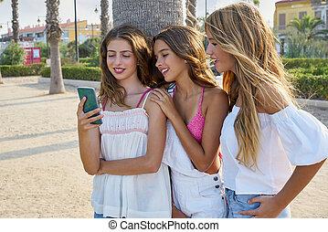 Teen best friends girls play with smartphone - Teen best...