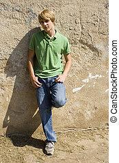 Teen Boy Against Wall