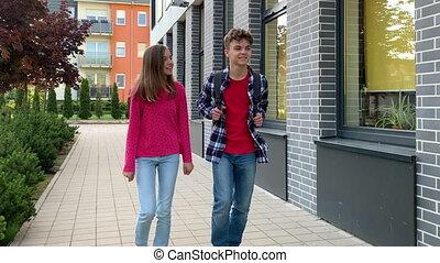 Teen boy and girl back to school - Two schoolchildren go to...