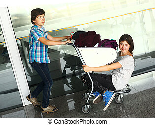 teen boy and girl waiting in the airport