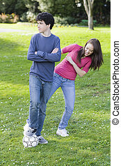 Teen Boy and Girl with Soccer ball