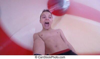 Teen boy at aqua park