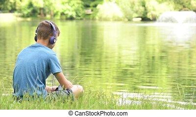 Teen boy at lakeside