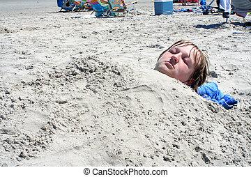 Teen Boy Buried in Sand