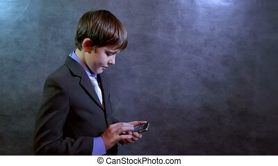 Teen boy businessman holding smart phone search on the internet social media networks