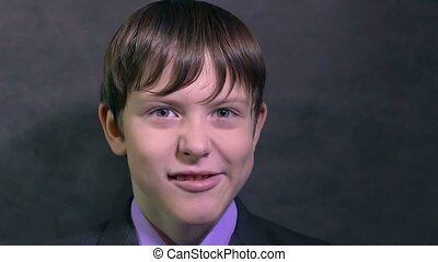 Teen boy businessman makes faces faces emotions mug slow motion