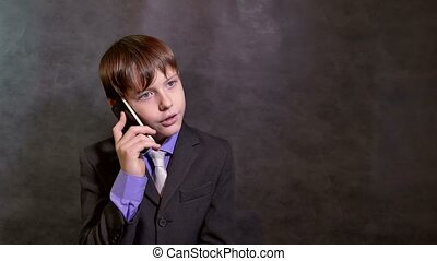 Teen boy businessman talking on the phone smartphone