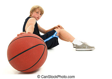 Teen Boy Child in Uniform Sitting with Basketball - Young...
