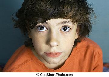 teen boy close up portrait with big eyes