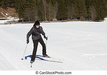 Teen boy cross country skiing