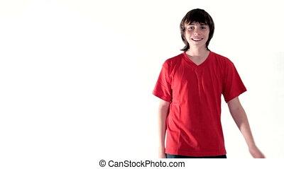 Teen boy dancing making face