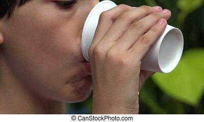 Teen Boy Drinking Beverage