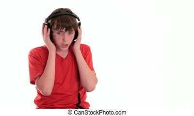 Teen boy enjoying music