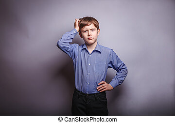 Teen boy holding his hand on head deep thought