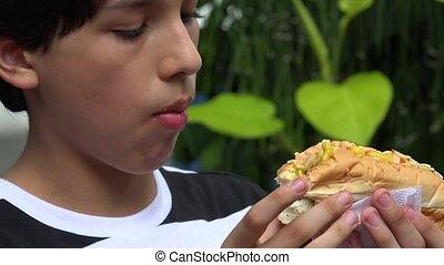 Teen Boy Holding Hotdog