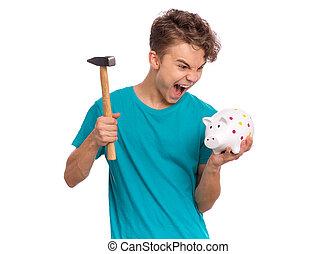 Teen boy holding piggy bank