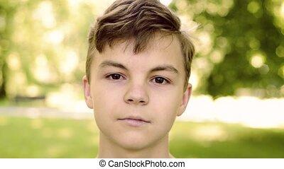 Teen boy in city park