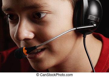 Teen boy in headset