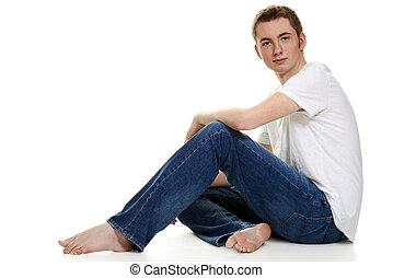 teen boy in jeans sitting