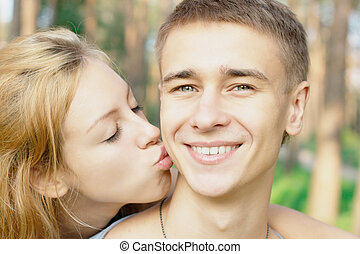 Teen boy kissed by a girl