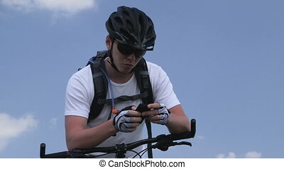 Teen boy on bike using smartphone