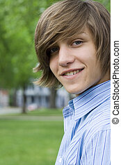 Teen Boy - Outdoor spring portrait of a teenaged boy and a...
