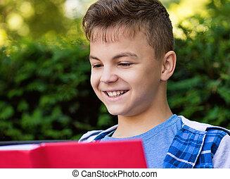 Teen boy reading book