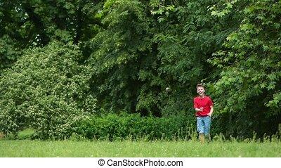 Teen boy running in park