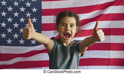 Teen boy shows gesture yes Independence Day American usa flag Fourth of July
