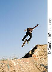 teen boy skateboarding - teen boy skateboarder playing on ...