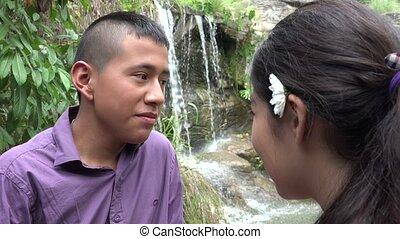 Teen Boy Speaking Outdoors