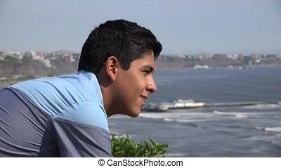 Teen Boy Staring At Ocean
