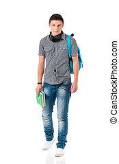 Teen boy student walking