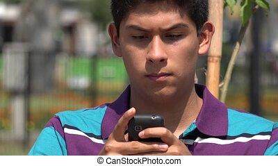 Teen Boy Texting Using Smartphone