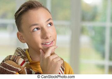 Teen boy thinking