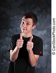 Teen boy thumbs up