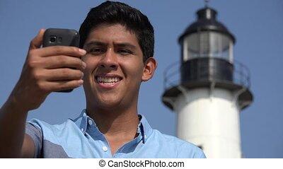Teen Boy Travel Selfie At Lighthouse