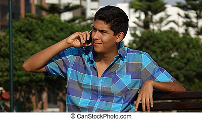 Teen Boy Using Cell Phone