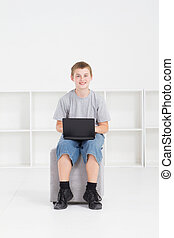 teen boy using laptop