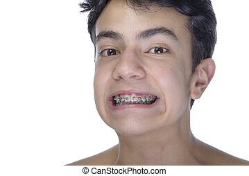 Teen boy wearing braces on white background - Cute teenager...